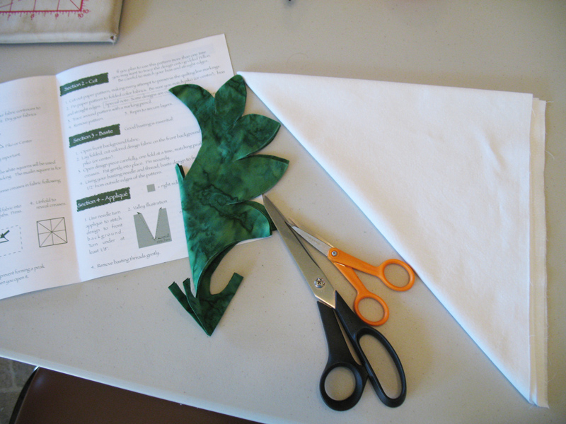 Cutting out the motif, folded in eighths.