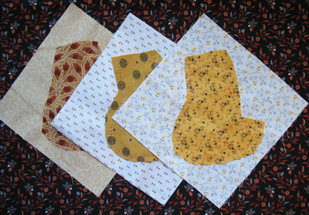 Vintage hand applique quilt in shopgoodwill